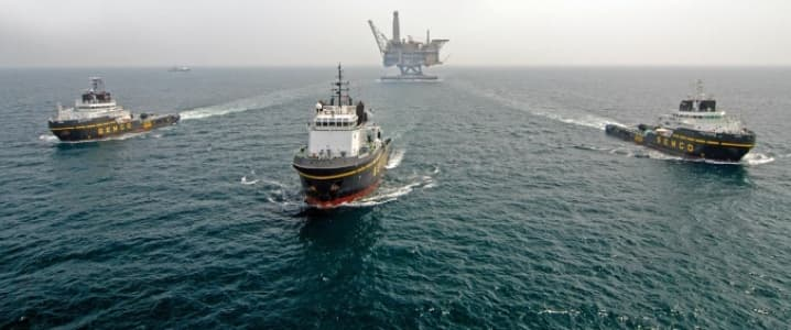 Offshore rig towed to location