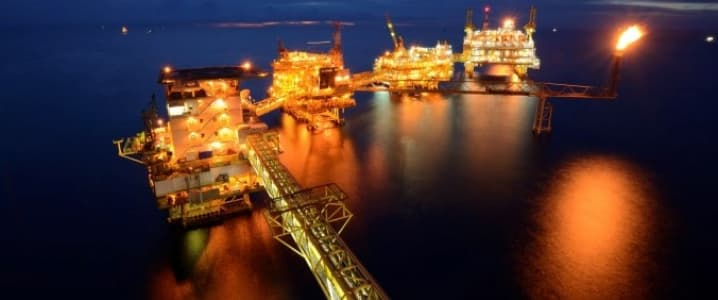 Offshore drilling platform by night