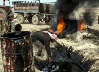 ISIS Forced To Cut Wages As Oil Revenues Tank