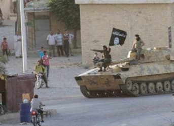 Islamic State Battles Kurds Over Border Town To Maintain Oil Trade