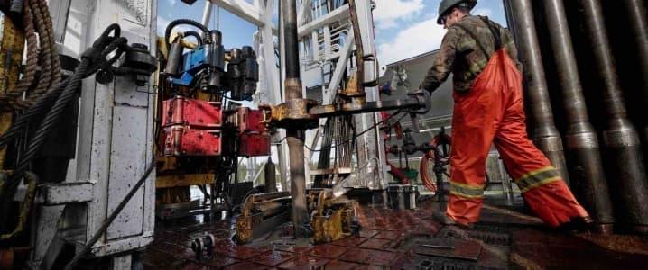 roughnecks at drilling pad