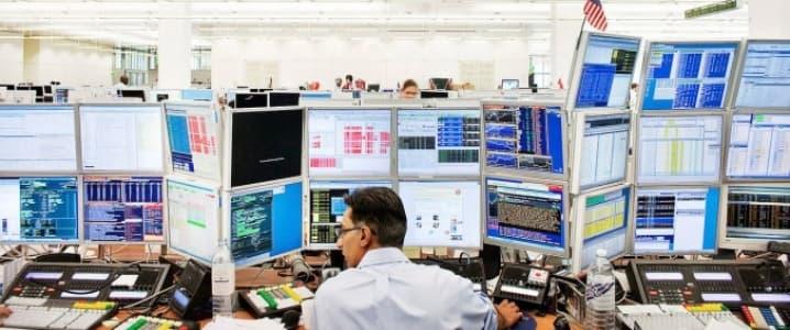 Trader behind computer