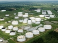 Oil Prices Inch Higher Despite Crude Build